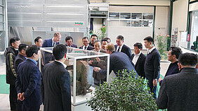 Chinese delegation and Andre Schulte-Südhoff gathered around first Schuko fan